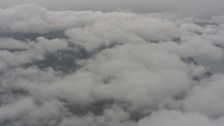 WA004_033 - 4K stock footage aerial video of patchy white clouds over Lake County, Oregon
