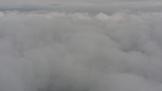 WA004_035 - 4K stock footage aerial video fly over white clouds above Washington