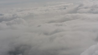 WA004_045 - 4K stock footage aerial video fly over a cover of clouds in Washington