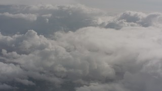 WA004_052 - 4K stock footage aerial video fly through misty clouds toward more clouds over Washington