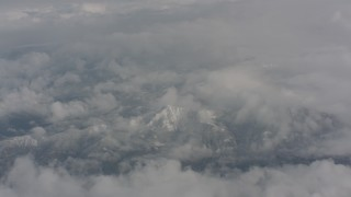 WA004_066 - 4K stock footage aerial video of snow-capped mountains beneath the clouds over Washington
