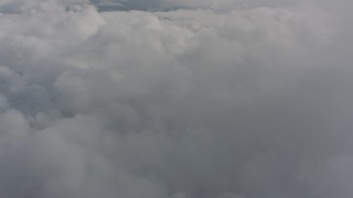 WA004_072 - 4K stock footage aerial video of flying over a wide expanse of clouds over Washington
