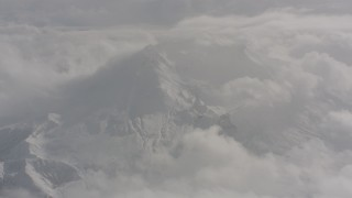 WA004_075 - 4K stock footage aerial video of turning from snowy Mount St. Helens in Washington