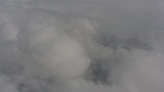 WA004_078 - 4K stock footage aerial video of flying by clouds over Skamania County, Washington