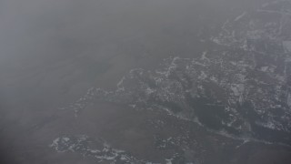 WA004_098 - 4K stock footage aerial video of a bird's eye view of snowy wilderness below misty clouds in Oregon