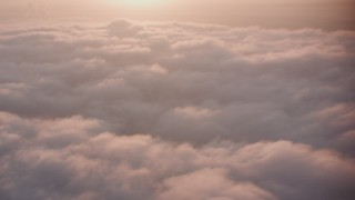 WA005_006 - 4K stock footage aerial video flyby sunset-lit clouds over Southern California