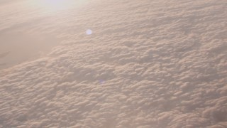 WA005_009 - 4K stock footage aerial video pan across a layer of clouds around the Port of Los Angeles at sunset, California