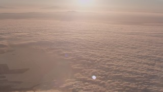 WA005_010 - 4K stock footage aerial video fly over cloud layer covering the Pacific Ocean at sunset near San Pedro, California