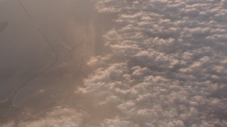 WA005_011 - 4K stock footage aerial video of a bird's eye view of clouds over ocean at sunset by Long Beach, California