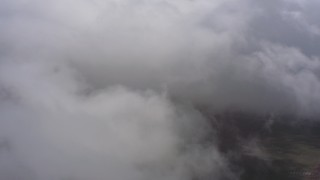 WA005_026 - 4K stock footage aerial video fly into dense white cloud cover over Southern California