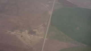 WA005_030 - 4K stock footage aerial video reverse view of clouds revealing circular crop fields below in Kansas