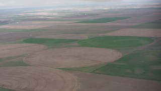 WA005_034 - 4K stock footage aerial video of a view across circular crops fields in Kansas