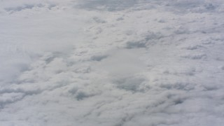 WA005_043 - 4K stock footage aerial video of flying above the clouds in Kansas