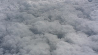 WA005_048 - 4K stock footage aerial video pan across a cover of clouds over Kansas