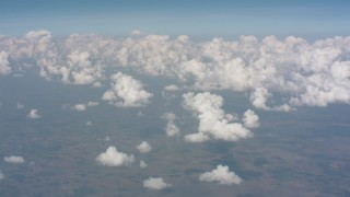 WA005_058 - 4K stock footage aerial video of a view of cloud formations over Kansas farmland