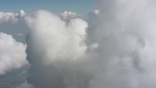 WA005_073 - Aerial stock footage of Fly over a cloud formation high above Ohio farmland