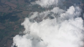 WA005_082 - 4K stock footage aerial video of tilt from larger cloud formations to smaller clouds over Ohio farmland