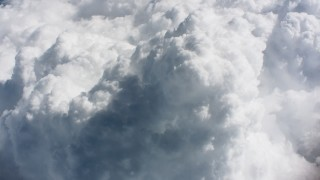 WA005_085 - 4K stock footage aerial video approach and tilt to a cloud formation high above Ohio farms
