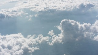 WA005_087 - Aerial stock footage of Tilt to clouds high above West Virginia farmland and river