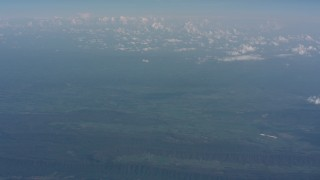 WA005_090 - Aerial stock footage of Approach a cloud above West Virginia, and tilt up to a wider view of mountains and countryside