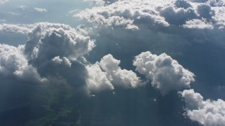WA005_092 - Aerial stock footage of Flyby clouds backlit by the sun over West Virginia