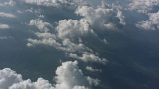 WA005_094 - Aerial stock footage of Tilt from a cloud to a wider view of cloud cover in the background over West Virginia