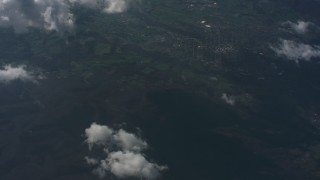 WA005_095 - Aerial stock footage of Tilt from clouds over West Virginia to a bird's eye view of mountains, lake and countryside