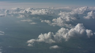 WA005_096 - Aerial stock footage of Tilt from a bird's eye of mountains to a view of clouds above West Virginia