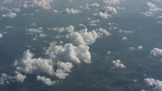 WA005_098 - Aerial stock footage of A view of partly cloudy skies above West Virginia, tilt to a cloud formation