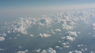 WA005_099 - Aerial stock footage of Tilt from clouds over countryside to a wider view of cloud cover over West Virginia