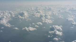 WA005_100 - Aerial stock footage of Passing clouds and hazy skies above West Virginia