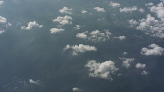 WA005_101 - Aerial stock footage of Pan across partly cloud skies over West Virginia countryside