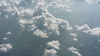 WA005_102 - Aerial stock footage of Tilt from a bird's eye view of farms to reveal clouds over West Virginia