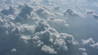 WA005_103 - Aerial stock footage of Flyby cloudy skies backlit by the sun over West Virginia