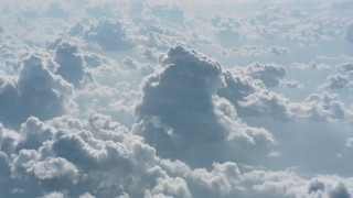 WA005_104 - Aerial stock footage of Cloudy skies backlit by the sun over West Virginia