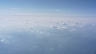 WA007_007 - 4K stock footage aerial video of hazy cloud cover high above North Carolina
