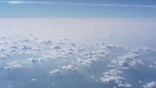 WA007_013 - 4K stock footage aerial video pan from a larger cloud formation to smaller ones over North Carolina