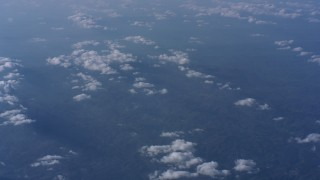 WA007_014 - 4K stock footage aerial video pan across patchy cloud cover high above North Carolina