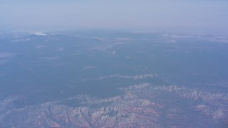 WA007_024 - 4K stock footage aerial video of a reverse view of mesas around the city, and tilt to reveal a distant mountain peak, Phoenix, Arizona