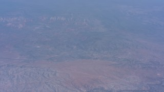 WA007_026 - 4K stock footage aerial video tilt from a view of Cottonwood, Arizona to desert mountains in the background