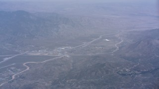 WA007_030 - 4K stock footage aerial video of a reverse view of the town of Cabazon and mountains, California