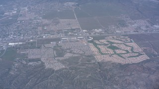 WA007_031 - 4K stock footage aerial video of suburban neighborhoods in Banning, California