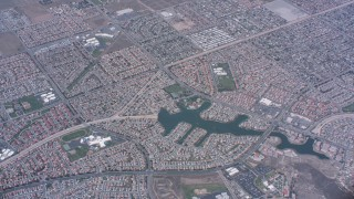 WA007_036 - 4K stock footage aerial video of a bird's eye view of suburban neighborhoods and lake in Moreno Valley, California