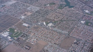 WA007_037 - Aerial stock footage of A reverse view of lake and suburban homes in Moreno Valley, California