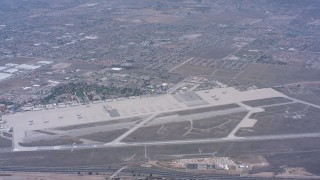 WA007_038 - 4K stock footage aerial video reverse view of March Joint Air Reserve Base and military planes in Riverside, California