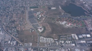 WA007_042 - 4K stock footage aerial video of a bird's eye view of suburban homes, I-15 and a lake in Norco, California