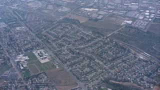WA007_043 - 4K stock footage aerial video of residential neighborhoods and schools in Norco, California