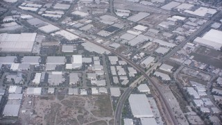 WA007_049 - 4K stock footage aerial video of railroad tracks and warehouse buildings in Santa Fe Springs, California