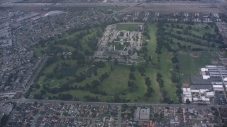WA007_050 - 4K stock footage aerial video fly over golf course to approach juvenile hall in Downey, California