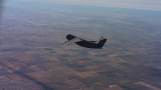 WAAF01_C009_0117WH - 4K stock footage aerial video of tracking a Lockheed C-5 flying over farmland in Northern California